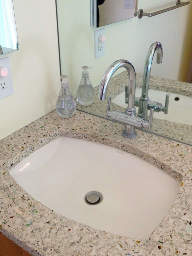 Shallow, undermount sink on a vertrazzo counter. Mostly taking the pic for the counter, which is made from recycled glass.